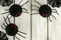 Halloween spider cupcake corner border on white wood Stock Images
