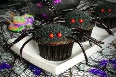 Halloween spider cupcakes with candy and holiday decor Royalty Free Stock Photography