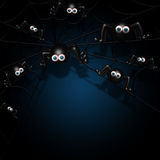 Halloween spiders on spider web with place for text over dark Royalty Free Stock Image