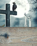 Halloween spooky background with cross and wooden frame Royalty Free Stock Image