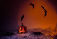 Halloween. Spooky Halloween Night,,halloween pumpkin, and many flying bats on abstract background with big moon and spiders Royalty Free Stock Photos