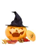 Halloween still-life. Halloween carved pumpkin with maple leafs and rowan berries Stock Images