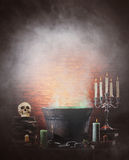 Halloween still-life background with a lot of different elements. Halloween background with a lot of different witchcraft tools: scull, candles, book, poison and Stock Image