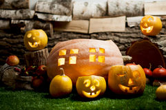 Halloween still life with carved pumpkins. Stock Photos
