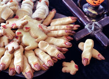 Halloween still life with close up of finger cookies and cross Royalty Free Stock Images