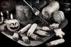 Halloween still life with finger cookies and witch objects in candle light_1 Stock Photo