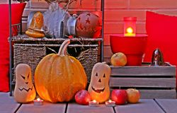 Halloween still life illuminated in a brick wall. royalty free stock images