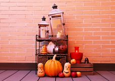 Halloween still life illuminated with pumpkins and candles. royalty free stock photo