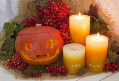 Halloween still life with pumpkin head and berries Stock Photography