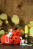 Halloween still life - pumpkin with  yellow leaves Royalty Free Stock Photos
