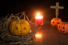 Halloween still life with pumpkins and candle on wooden floor Royalty Free Stock Photography