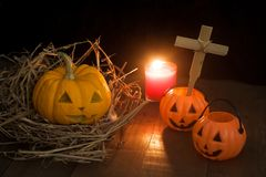 Halloween still life with pumpkins and candle on wooden floor Stock Photography