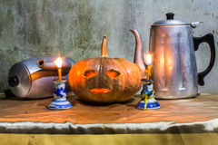 Halloween still life with pumpkins,  candles and classic kettle Royalty Free Stock Photos