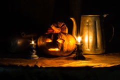Halloween still life with pumpkins,  candles and classic kettle Stock Photo