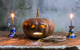 Halloween still life with pumpkins, candles and rosary Royalty Free Stock Images