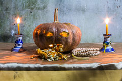 Halloween still life with pumpkins, candles and rosary Royalty Free Stock Image