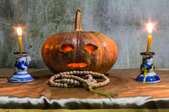 Halloween still life with pumpkins,  candles and rosary Stock Images