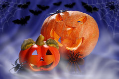 Halloween still life with pumpkins glowing in the night Royalty Free Stock Images