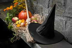 Halloween still life with pumpkins and witch hat. And broom royalty free stock images