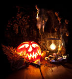 Halloween still life. Scary Halloween pumpkin, mushroom, candles Royalty Free Stock Photos