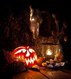 Halloween still life. Scary Halloween pumpkin, mushroom, candles Stock Photo