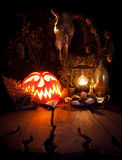 Halloween still life. Scary Halloween pumpkin, mushroom, candles Stock Images