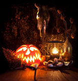 Halloween still life. Scary Halloween pumpkin, mushroom, candles Royalty Free Stock Image