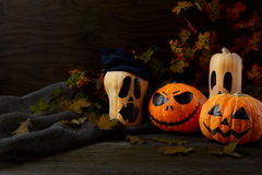 Halloween Stingy Jack pumpkins on rustic background, copy space Stock Photo