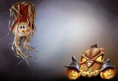 Halloween strawberry doll with pumpkins smoke background horror text royalty free stock photos