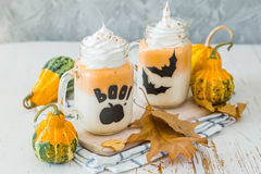 Halloween style pumpkin spice latte in glass jar Stock Photos