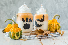 Halloween style pumpkin spice latte in glass jar Royalty Free Stock Photos
