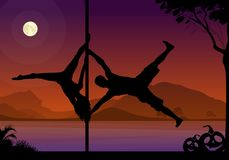Halloween style silhouettes of male and female pole dancer performing duo tricks in front of river and full moon at night. Royalty Free Stock Photos