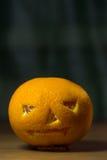 Halloween style tangerine stock photos