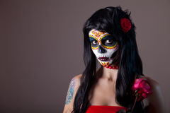 Halloween sugar skull girl with red rose. Day of the Dead theme stock images
