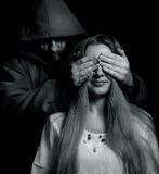 Halloween surprise - evil man behind innocent girl. Halloween surprise - evil man behind innocent naive girl royalty free stock images