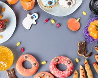 Halloween sweet treats, party food concept. Scary cookies and apples dipped in chocolate stock photography