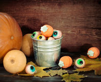 Halloween sweets, autumn leaves and pumpkins Stock Photography