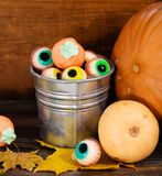 Halloween sweets, autumn leaves and pumpkins Royalty Free Stock Photo