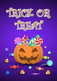 Halloween sweets and candies in pumpkin bucket Royalty Free Stock Photo