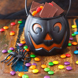 Halloween Sweets chocolate candy in pumpkin bowl, spide Royalty Free Stock Images