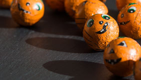 Halloween sweets with cute faces and shadows. stock photo