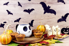 Halloween sweets and leafs Royalty Free Stock Images