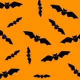 Halloween symbol. Pattern of flying bats. Black bats on orange background. Silhouette. Cartoon. Vector illustration stock illustration