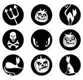 Halloween symbols. White silhouettes of pumpkins, cats, skull, trident and eyes on a black background. Symbols of a Halloween Royalty Free Stock Photos