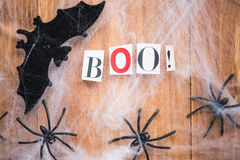 Halloween Symbols Bats, Web and Black Spiders on Wooden Backgrou Royalty Free Stock Photo