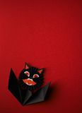 Halloween symbols origami on a red background Royalty Free Stock Image