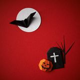 Halloween symbols origami on a red background Royalty Free Stock Photo