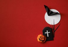 Halloween symbols origami  on a red background. Halloween symbols origami bat on moon and pumpkin on a red background Royalty Free Stock Photos