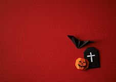 Halloween symbols origami on a red background Stock Photo