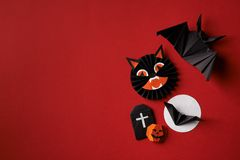 Halloween symbols origami  on a red background Stock Photos